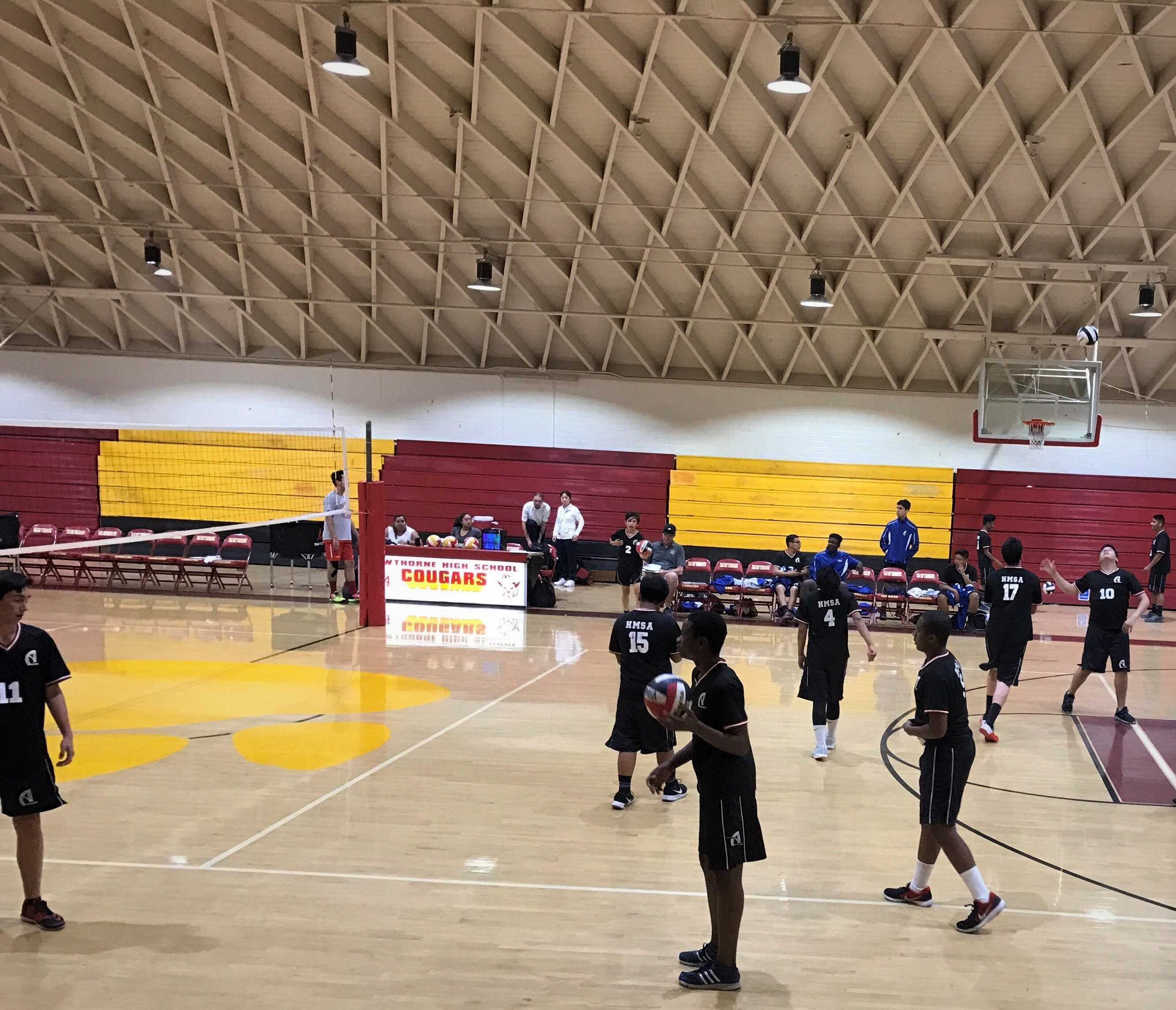 The Boys Volleyball Team warming up before their game against Hawthorne High.