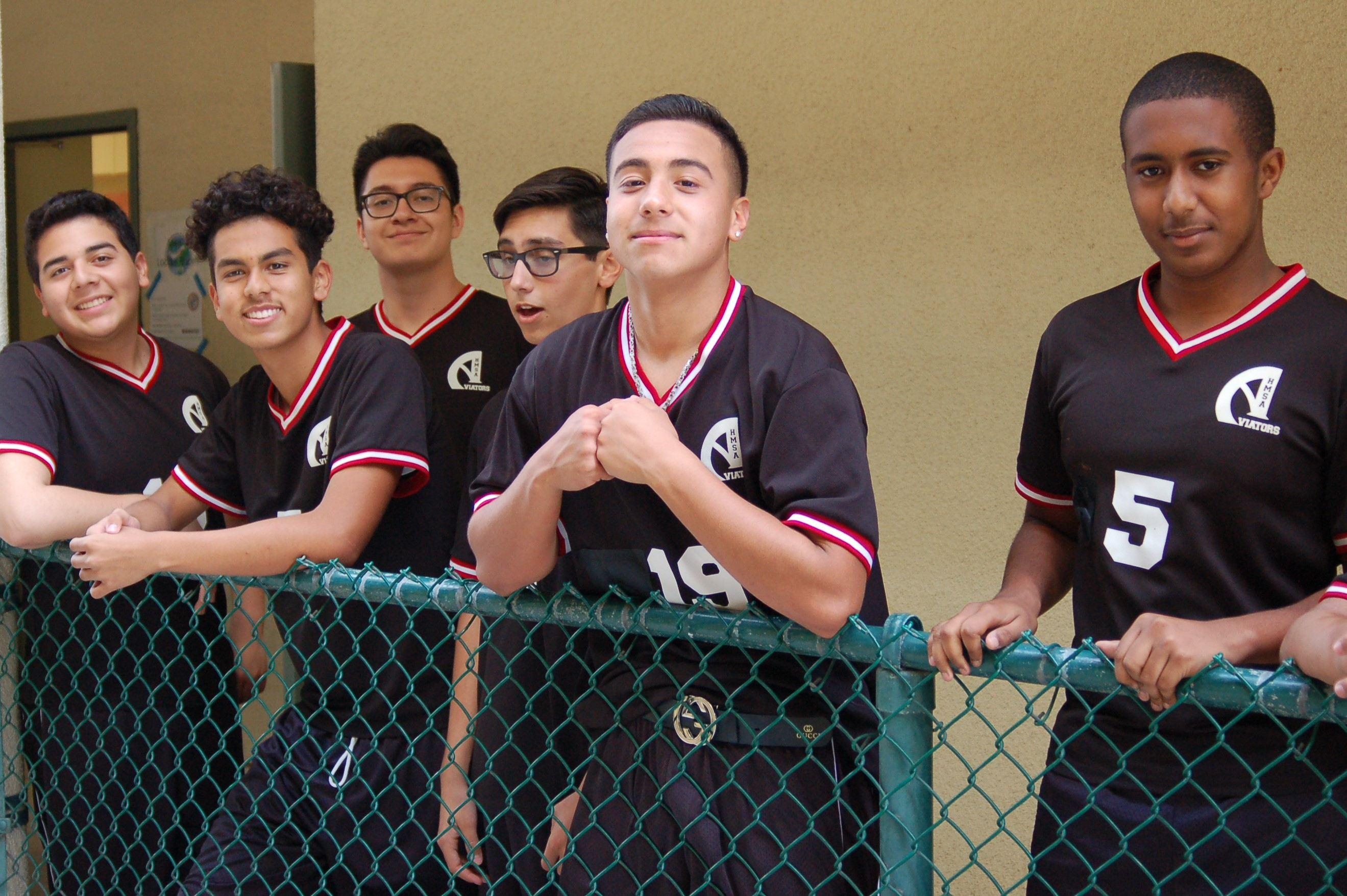 The boys volleyball team get ready for pep rally.