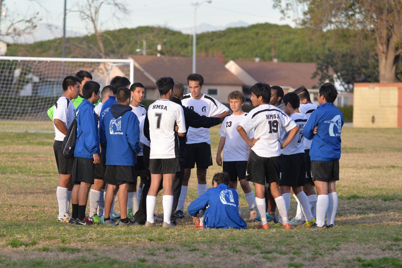 The boys' soccer team huddles up after a match. Photo provided by Randy Launius.