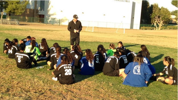 The girls huddle up during halftime to receive instructions from Coach Kircher. Photo taken by Miguel Sanchez.