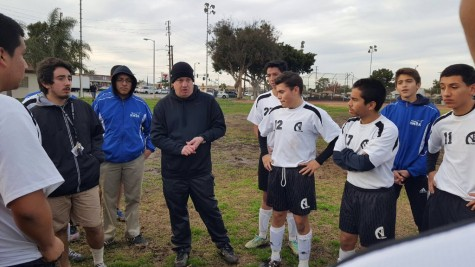 Despite being up 3-0 at halftime, Coach Launius wanted the Aviators to build onto their lead as he talks to them at halftime. Photo taken by Richard Estrella.