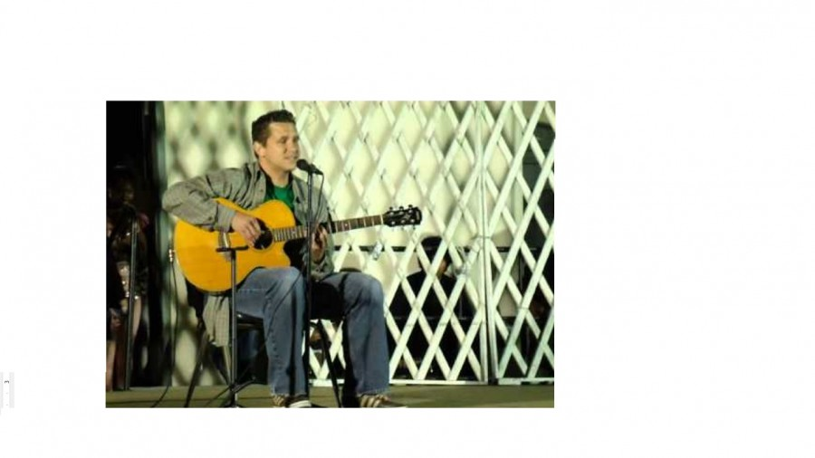 Image from Mr. Jahnke performing at the 2013 Talent Show by MiracleeCream. Photo via Youtube under Creative Commons license.