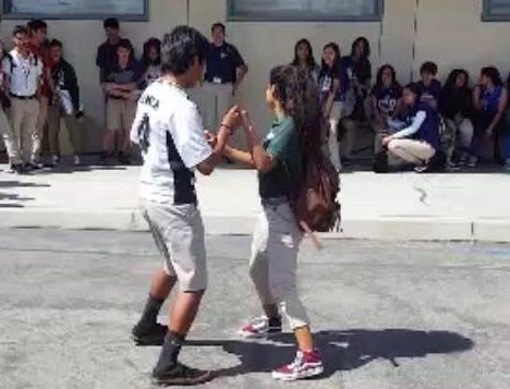 Sophomores Erick M. and Karen Z. participating in a dance battle during the last pep rally. Photo provided by Sophomore Alfredo C.