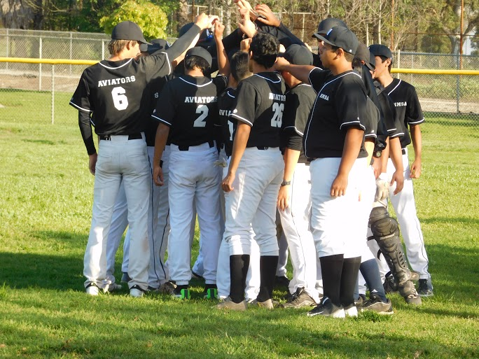 The boy's baseball team huddle up during a game. Photo provided by Gina Sharpe.