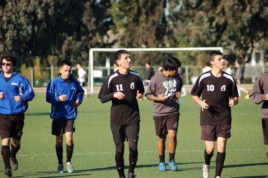 The Calm before the Storm. The boys warm up right before their game. (Photo by Fortune S.)