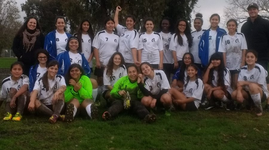 HMSA's girls soccer team poses for a team picture after a hard-fought game in the mud at Alondra Park. Despite the harsh weather, victory went to HMSA's girls soccer team! (Photo by Xochitl A.)
