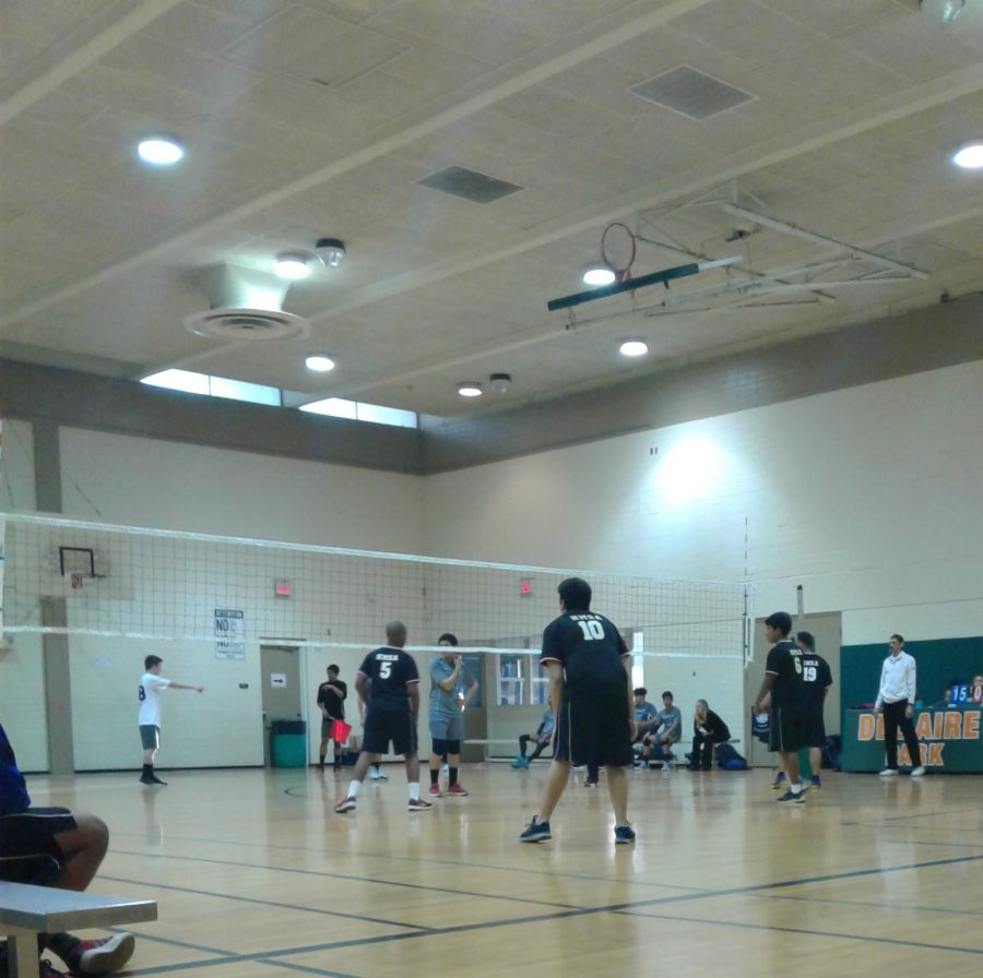 The boys volleyball team plays against Davini Science at Del Aire Park. Both varsity and jv won that day.