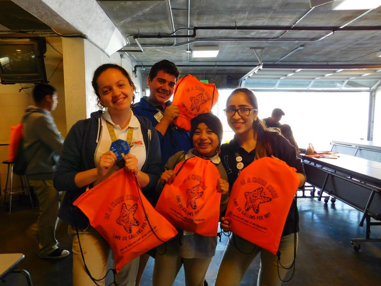 Students receive Water Basin bags.