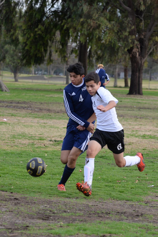 Esteban Becerra battling on a 50-50 ball against an offensive New Roads' player.  (Photo Source: Mr. Launius)