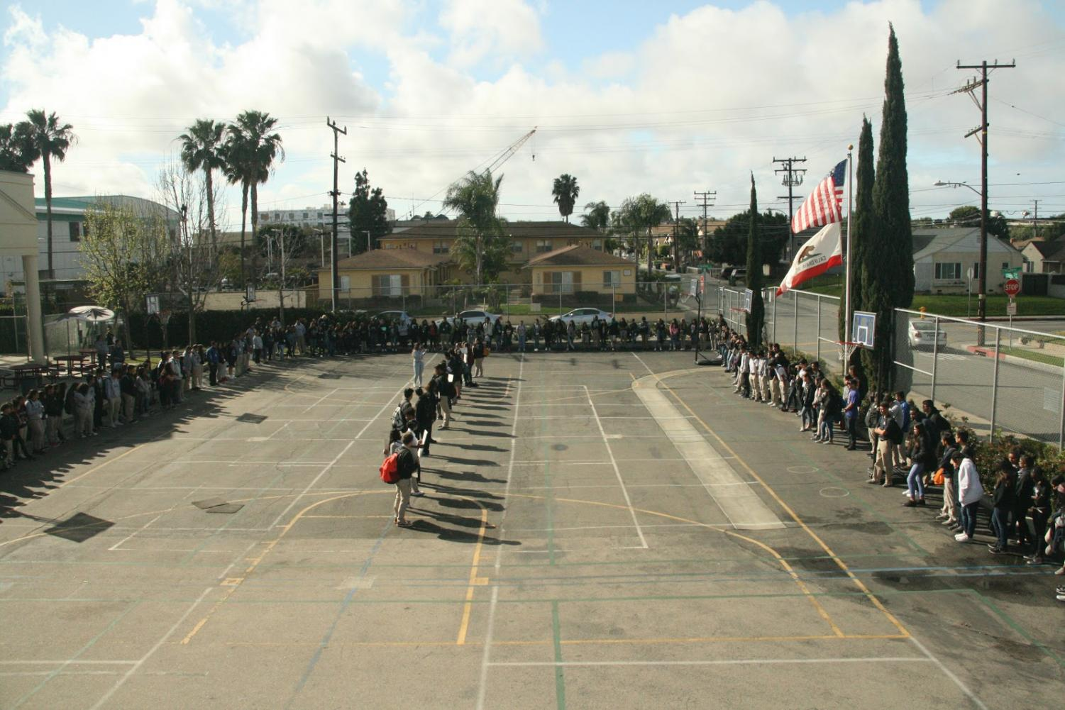 HMSA students and staff gathered on the blacktop for the memoriam.