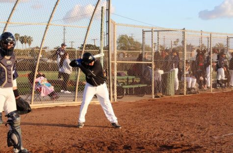 Eric G. in position for batting in their baseball game against New Roads ( Photo Source: Pedro Adame).
