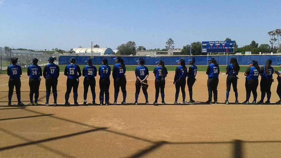 The lady A's lining up before a game (Photo Source: Mr. Dura).
